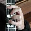 Randy 's fingers forming a chord
